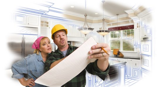 Male Contractor in Hard Hat Discussing Plans with Woman, Kitchen